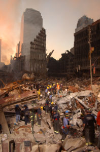 New York City, NY, September 16, 2001 --  Fire fighters and Urban Search and Rescue teams work amidst the rubble of the collapsed World Trade Center. Photo by Andrea Booher/ FEMA News Photo